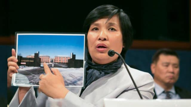 """<b>RECOUNTING THE HORRORS</b>  •  Yin Liping testifies before the Congressional-Executive Commission on China, April 14 2016, on """"China's Pervasive Use of Torture."""" Ms. Yin is a Falun Gong practitioner who survived torture, forced labor, and sexual violence in Masanjia and other forced labor camps in China."""